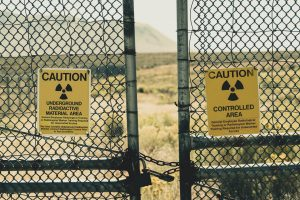 Nuclear waste signs on fence urging caution
