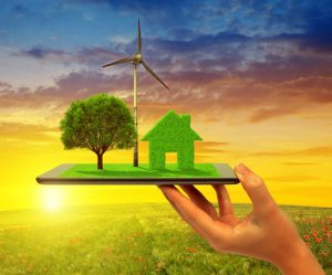 REDEEMA's device will measure greenhouse gases. The picture therefore shows a tree, turbine and house made of grass on a tablet device.