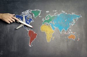 toy airplane on colourful world map