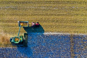 Birds eye view of farm - visible tractor and crops in field