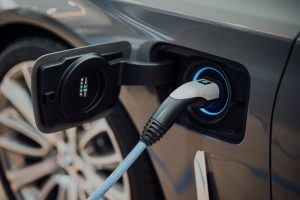 Zero emissions vehicles - electric car plugged in charging